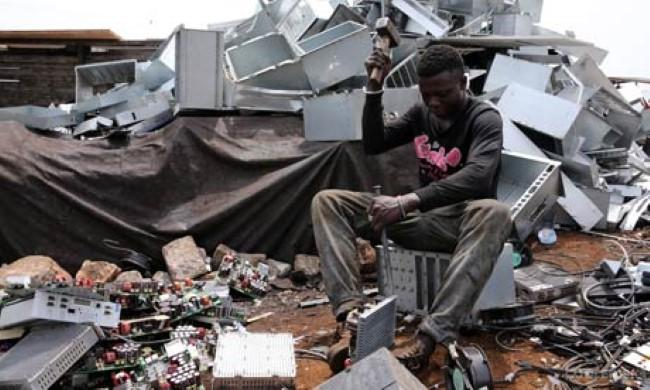 MDG : Electronics waste or e-waste in Africa : Teenage boys dismantle computer in Accra, Ghana